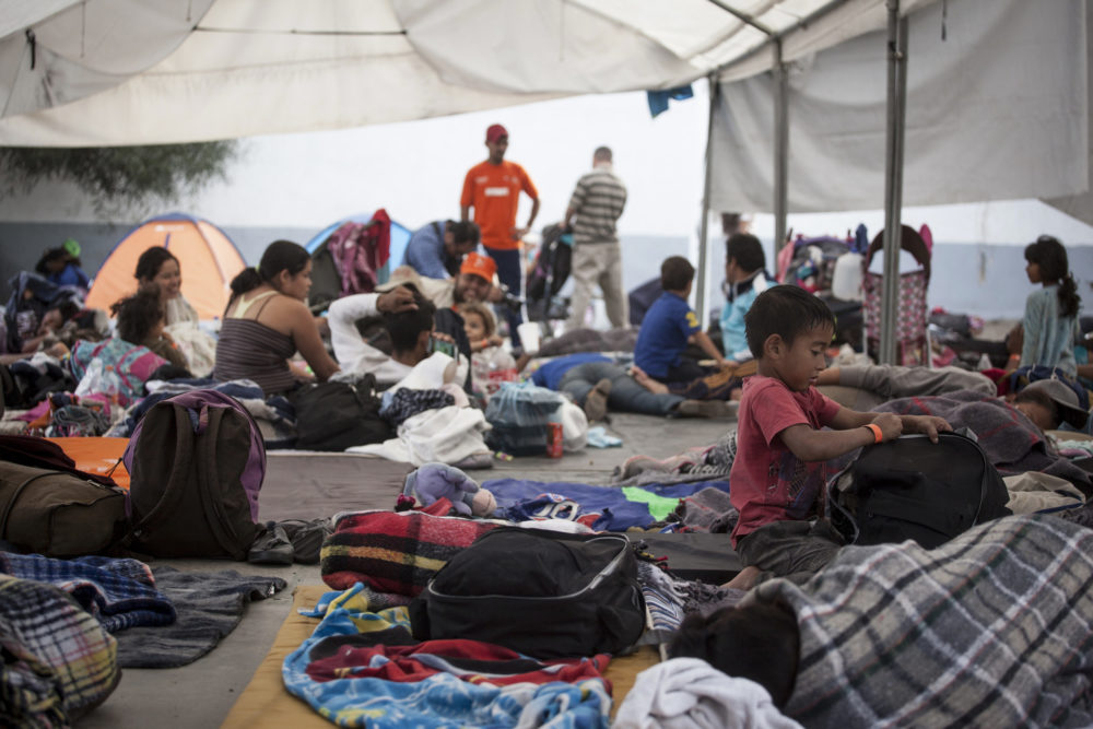 Central American migrants rest in a temporary shelter Tijuana officials opened at the Unidad Deportiva Benito Juárez sports center on Nov. 15, 2018. Many say they are fleeing gang violence in their home countries. (Erin Siegel McIntyre/KQED)
