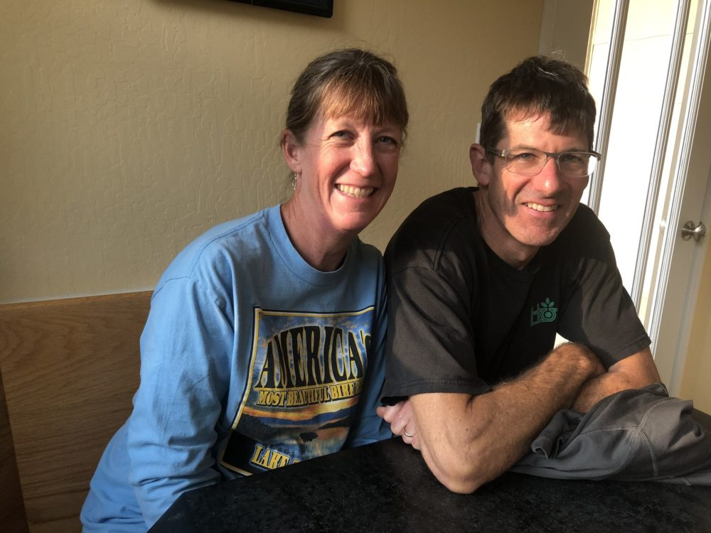 """Ann and Kent Moriarty sit at their home in Pinole, California, on Nov. 18, 2018. """"Dealing with immigration is confusing. We are not lawyers. Quite often we are in the position of not knowing what's the next step to take,"""" said Kent, about trying to support Veronica Aguilar and another Salvadoran family seeking asylum whom they are hosting. (Farida Jhabvala Romero/KQED)"""