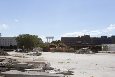 """Seen here in 2016, the site of the former Bayside Expo Center, on Columbia Point, is among the city of Boston's """"Opportunity Zones."""" (Joe Difazio for WBUR)"""