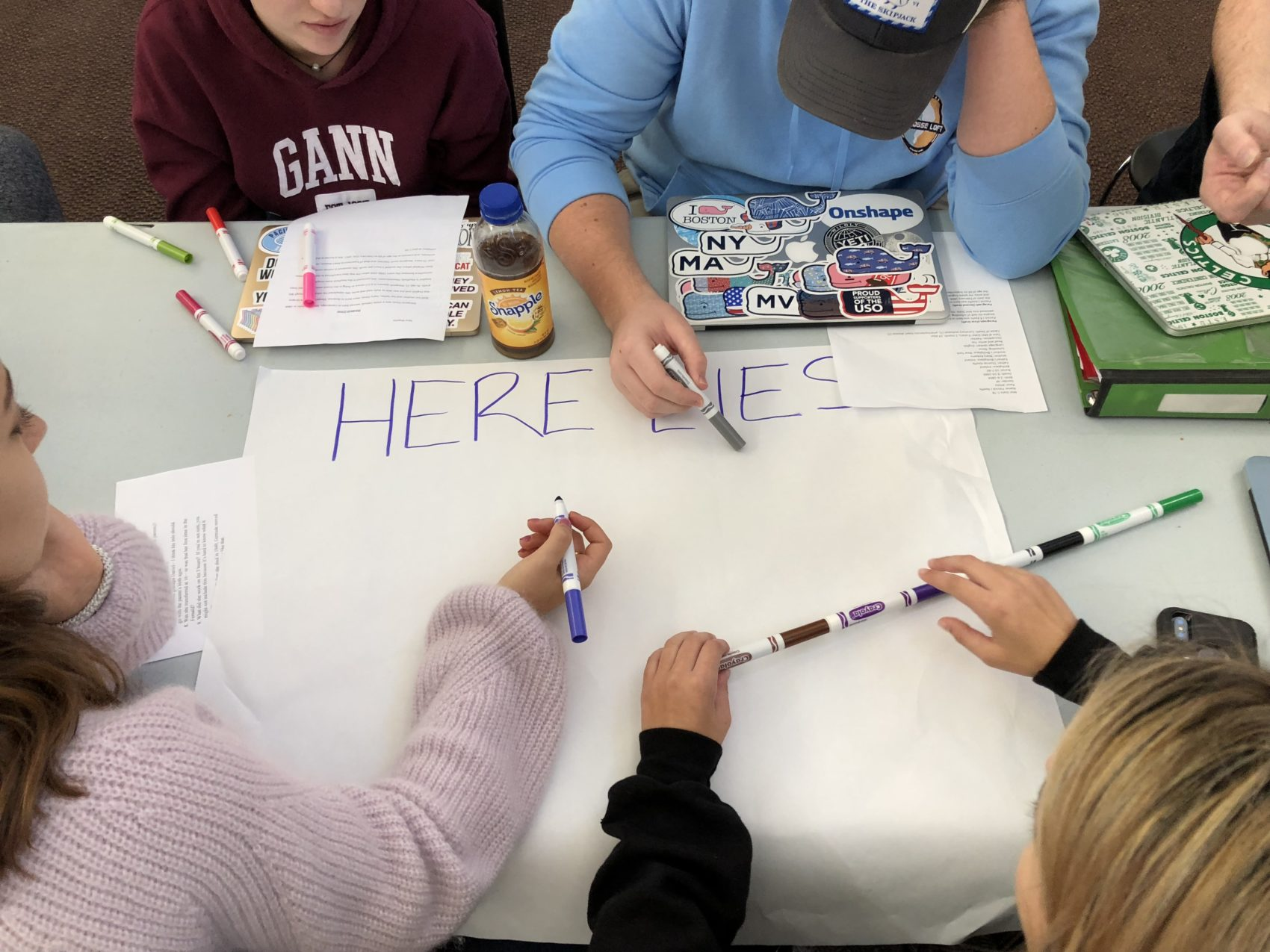 Students at Gann Academy design a new sign to identify the Metfern Cemetery in Waltham to passersby. (Eve Zuckoff/WBUR)