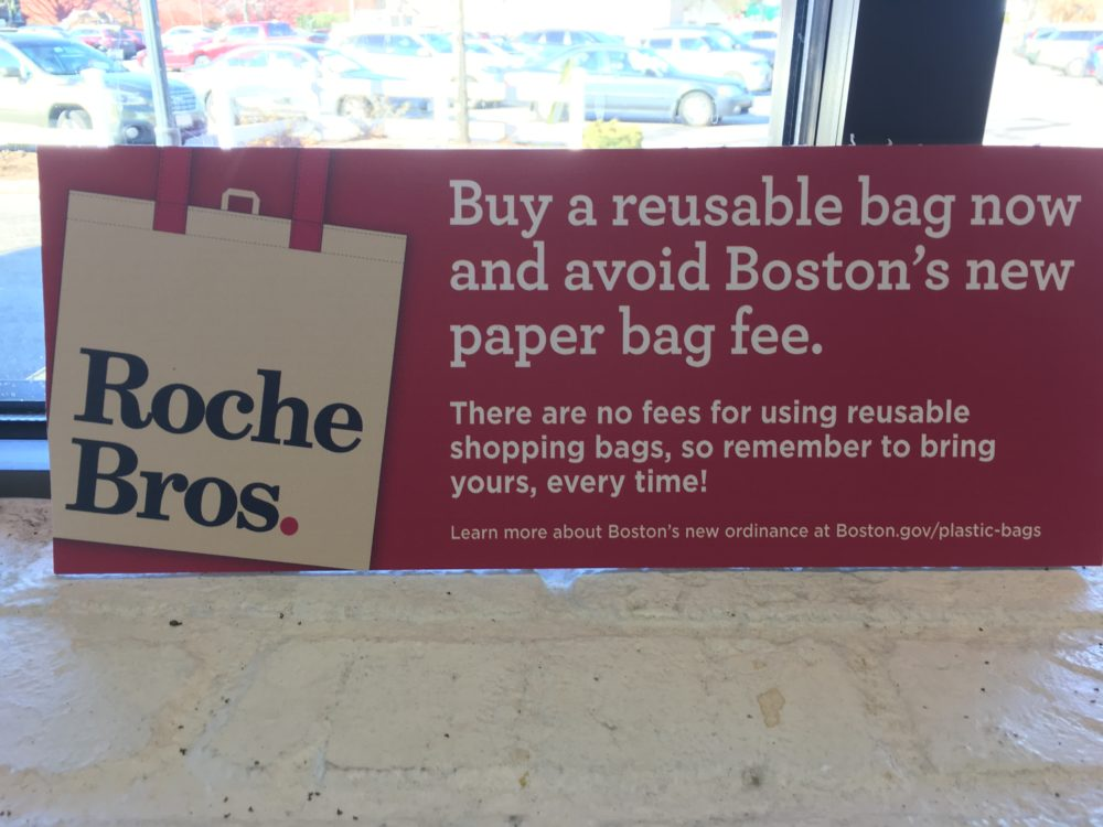 A sign at Roche Bros. warning of the plastic bag ban (Dan Guzman/WBUR)