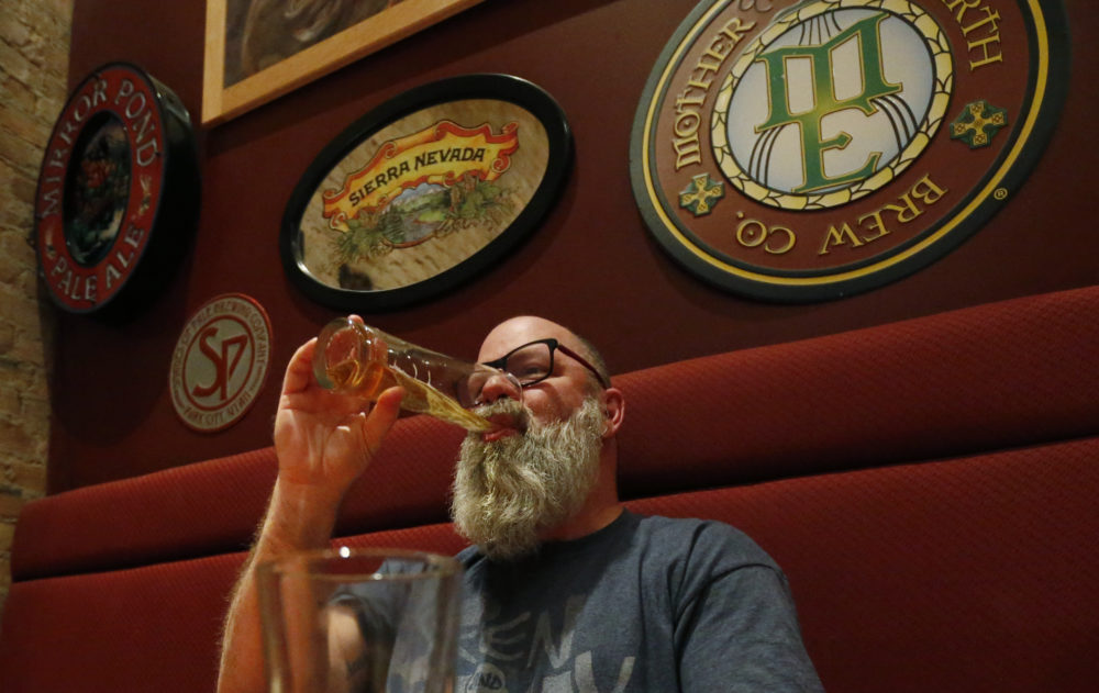 In this Dec. 20, 2018, photo, Rob Wheatley, 50, drinks a beer, at the Beer Hive Pub, in Salt Lake City. The United States' lowest DUI threshold has taken effect in Utah. Lawmakers in the state approved the 0.05 percent blood-alcohol limit in 2017, and Gov. Gary Herbert signed it into law. (Rick Bowmer/AP)