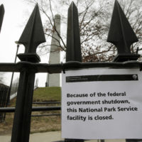 A sign is posted on a fence near an entrance to the Bunker Hill Monument Dec. 24 in Boston. The historic site, erected to commemorate the Revolutionary War Battle of Bunker Hill, and run by the National Park Service, was closed due to a partial federal government shutdown. (Steven Senne/AP)