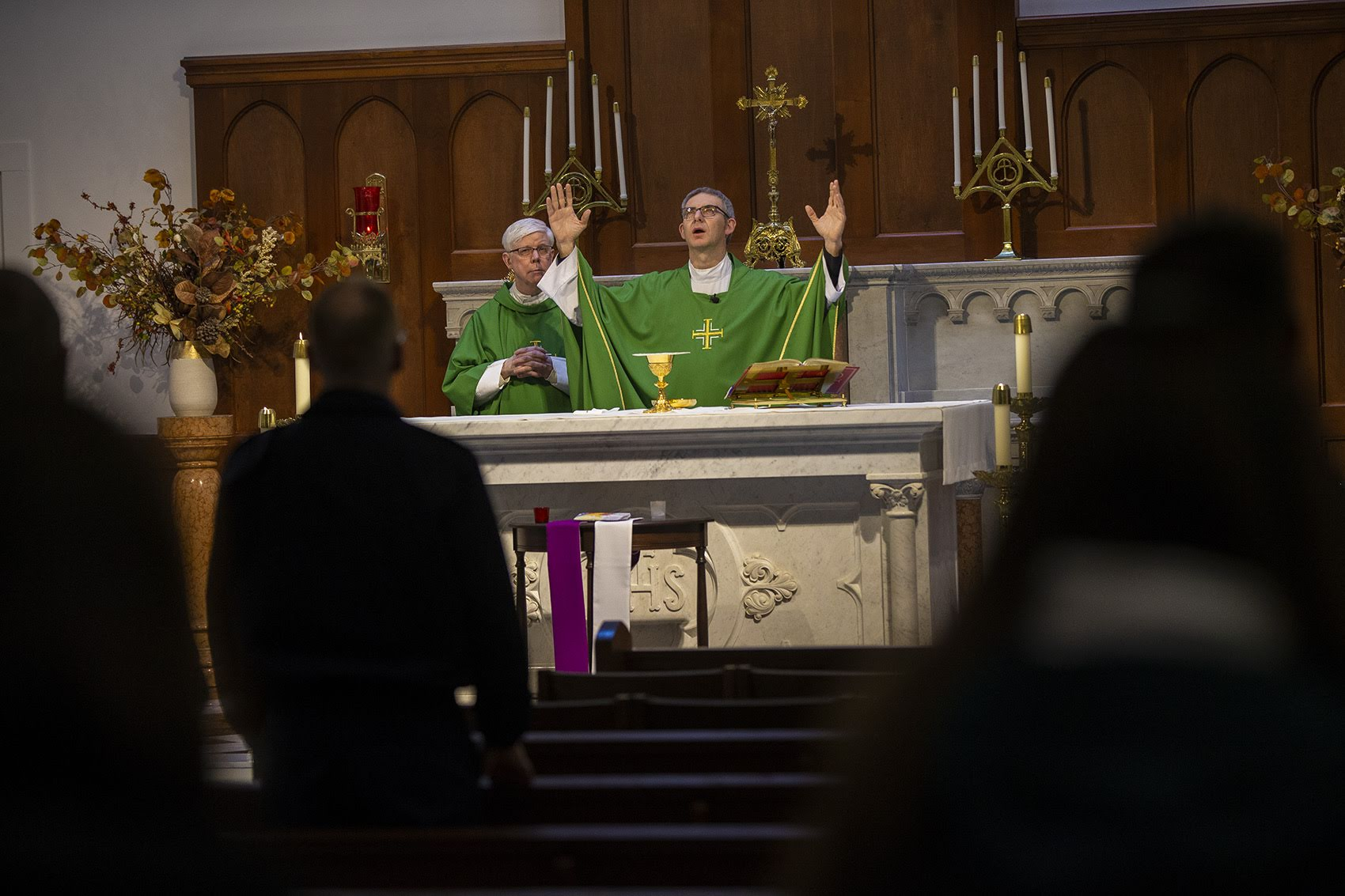 Father Paolo Cumin leads the noon Mass at Shrine of Our Lady of Good Voyage in the Seaport. (Jesse Costa/WBUR)
