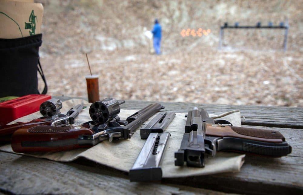 Guns point down a range at the Harvard Sportsmen's Club in Harvard, Mass. (Robin Lubbock/WBUR)