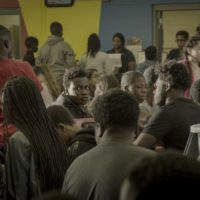 Andrew Bleechington, center facing camera, sits in the school cafeteria. (Courtesy CFI Releasing)