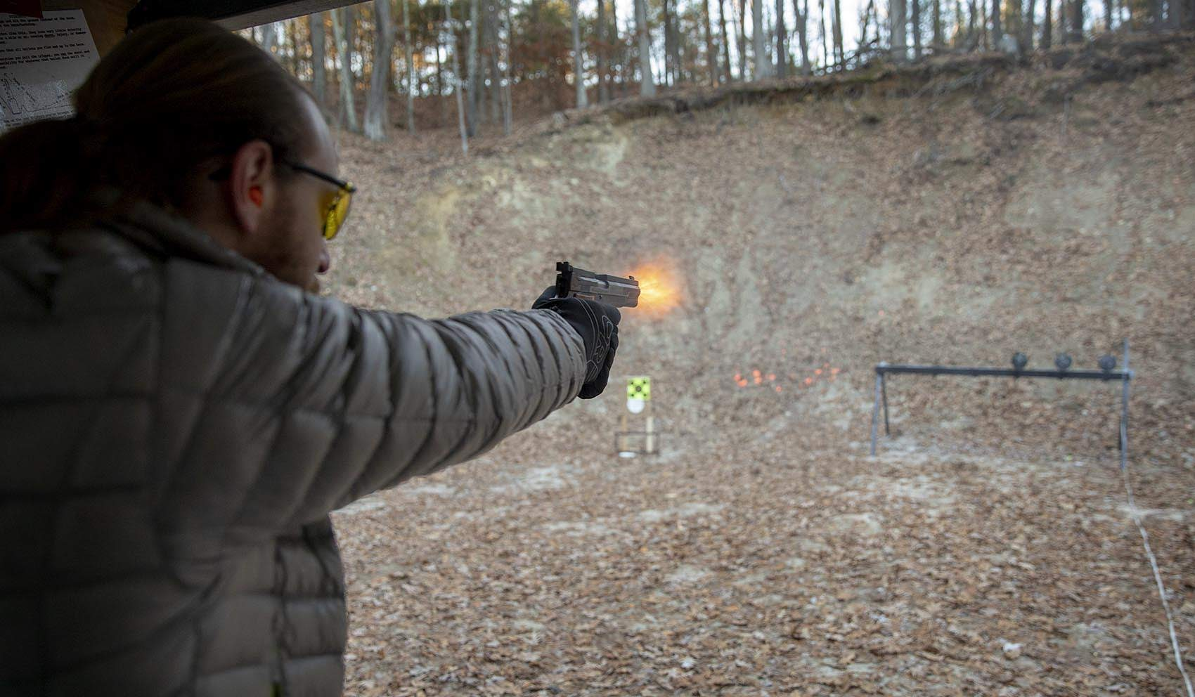 Aaron Grossman, an NRA instructor and leader of the Boston Pink Pistols, fires at targets at the Harvard Sportsmen's Club in Harvard, Mass. (Robin Lubbock/WBUR)
