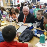 Agriculture Secretary Sonny Perdue has lunch with students in the cafeteria at Catoctin Elementary School in Leesburg, Va., Monday, May 1, 2017, after he unveiled a new rule on school lunches as the Trump administration and other Republicans press for flexibility after eight years of the Obama's emphasis on health eating. (Carolyn Kaster/AP)