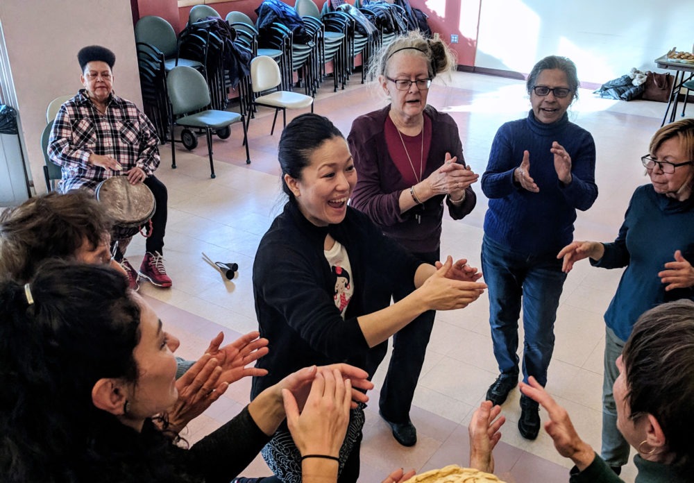 Yosi Karahashi leads her class at the Cambridge Senior Center. (Jessica Ullian for WBUR)