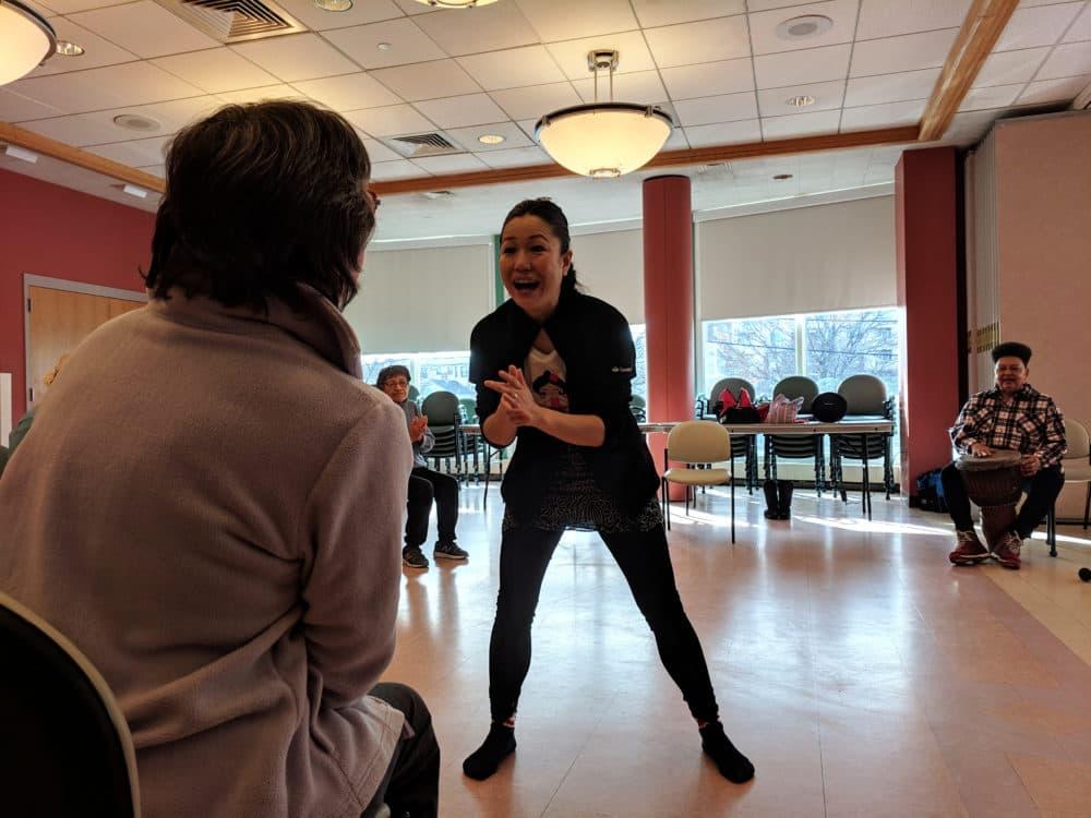 Yosi Karahashi works with Sandra Corsetti at the Cambridge Senior Center. (Jessica Ullian for WBUR)