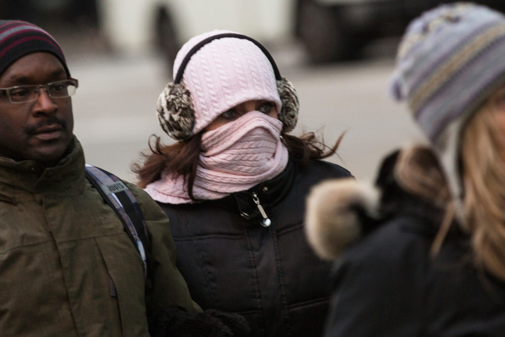 A woman bundles up against the cold in New York City on Jan. 8, 2014, after a polar vortex descended from the Arctic on much of the country. (Andrew Burton/Getty Images)