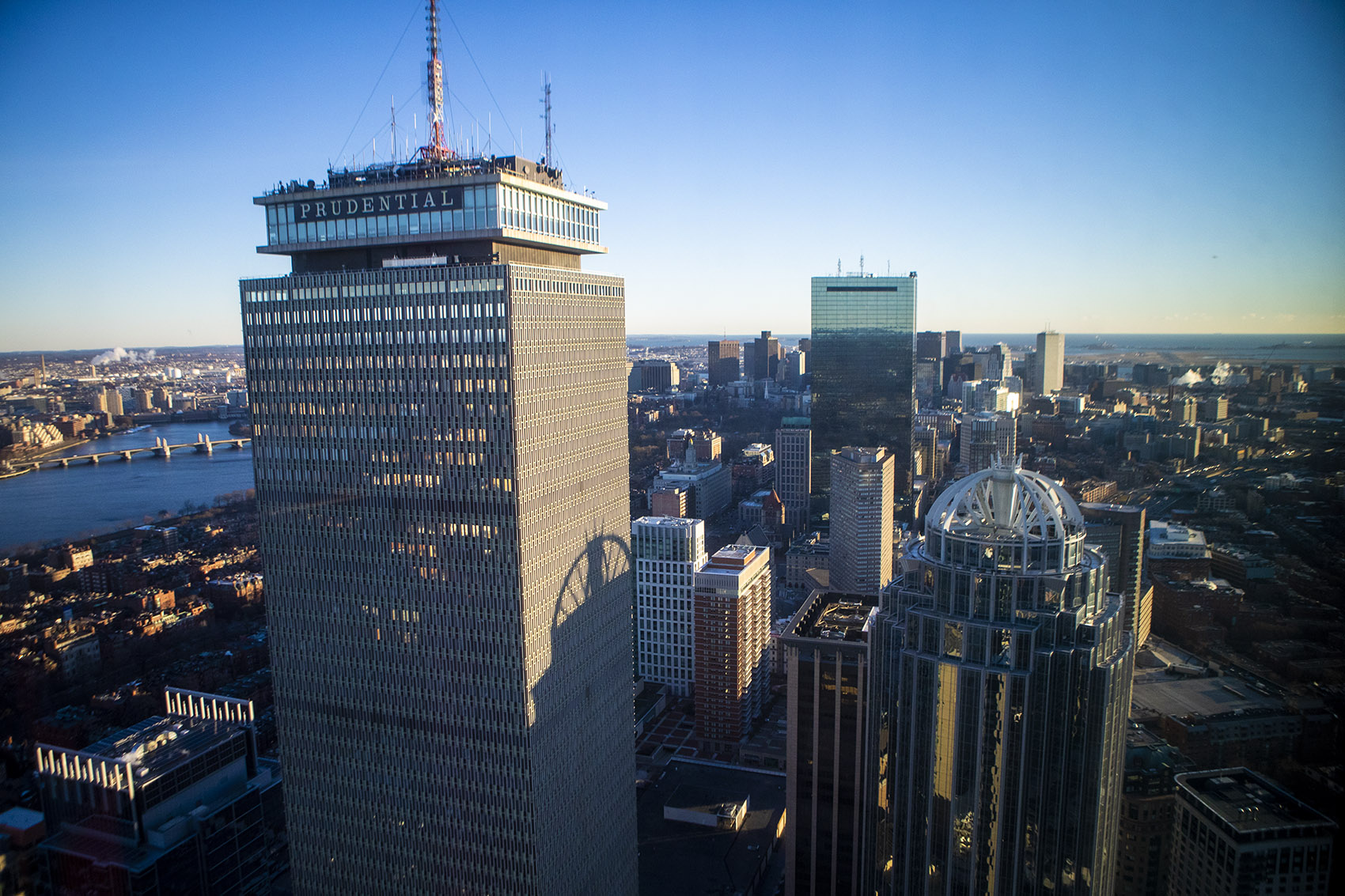 The two tallest buildings in Boston, 200 Clarendon Street (formerly known as the John Hancock Tower), right, and the Prudential Tower are seen from One Dalton. (Jesse Costa/WBUR)