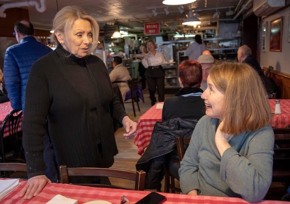 Head waitress Gina Schertzer chats with former waitress Joyce Monac. (Robin Lubbock/WBUR)