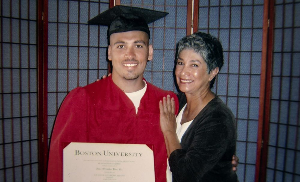 José Bou, with his degree from Boston University, stands with Joann Mizell, who Bou says has been a mother figure in his life. (Robin Lubbock/WBUR)