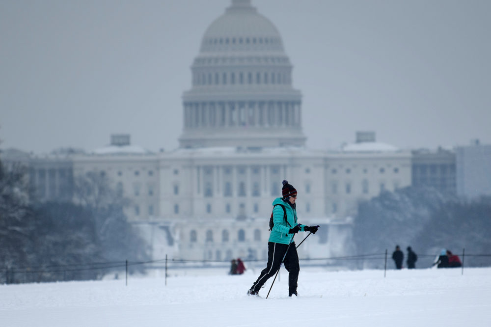 A cross-country skier passes the U.S. Capitol on the National Mall on the 23rd day of a government shutdown during a winter storm on Jan. 13, 2019 in Washington, D.C. (Brendan Smialowski/AFP/Getty Images)