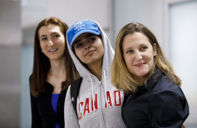 Asylum-seeker Rahaf Mohammed al-Qunun, 18, smiles as she is introduced to the media at Toronto Pearson International Airport, alongside Canadian Minister of Foreign Affairs Chrystia Freeland, right, on Jan. 12, 2019 in Toronto, Canada. Al-Qunun, a Saudi Arabian woman who fled her family saying she feared for her life, landed in Canada. (Cole Burston/Getty Images)