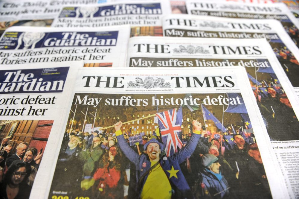 An arrangement of daily newspapers photographed in London on Jan. 16, 2019, shows front pages reporting on the U.K. Parliament's rejection of the government's Brexit deal. (Daniel Sorabji/AFP/Getty Images)