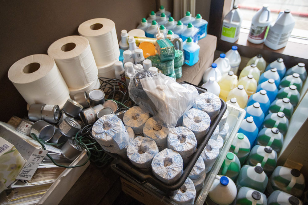 Even cleaning supplies and paper products were being auctioned off at the L'Espalier auction. (Jesse Costa/WBUR)