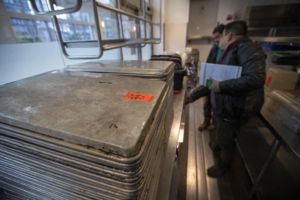 Sheet pans at the L'Espalier auction. (Jesse Costa/WBUR)