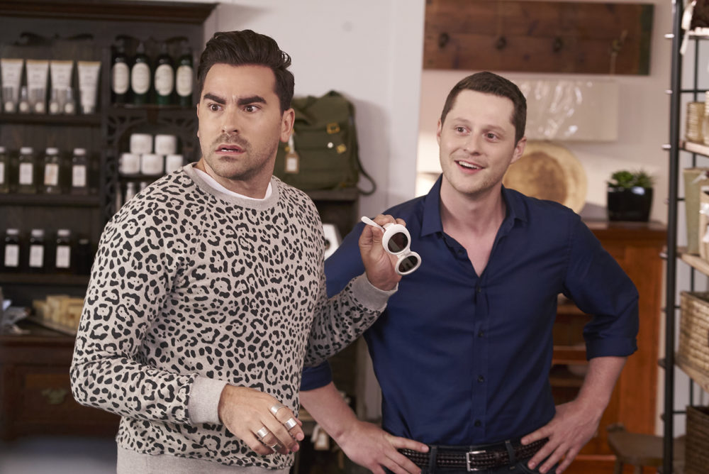 "David (Daniel Levy, left) and Patrick (Noah Reid) in a scene from season 4 of ""Schitt's Creek."" (Courtesy of POPtv)"