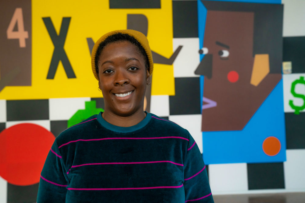 Nina Chanel Abney in front of her self-titled installation at the ICA. (Courtesy Ernesto Galan)