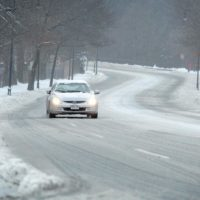 A car makes it's way down a snowy Route 2 in Cambridge, Mass. (Robin Lubbock/WBUR)