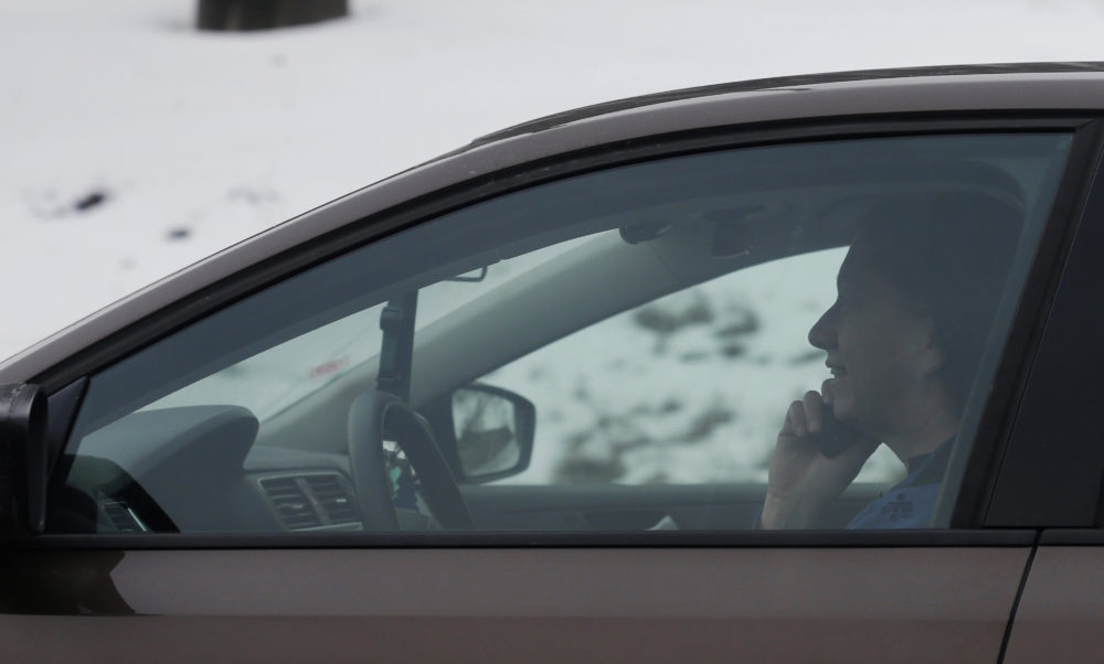 A motorist talks on a cellphone while driving on a highway in Chicago in 2013. (Nam Y. Huh/AP)