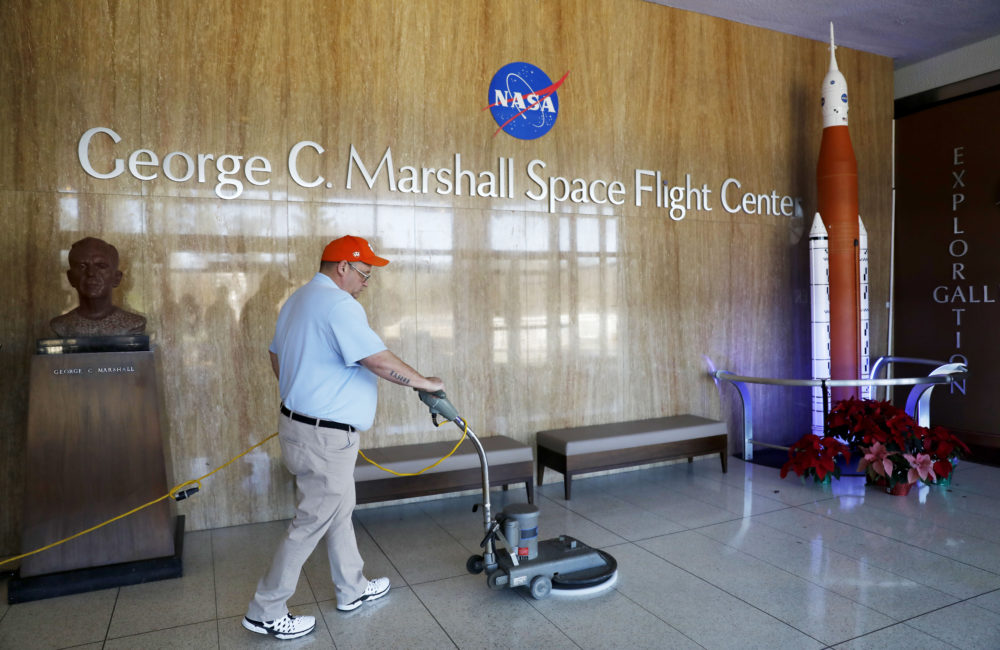 A worker cleans the floors at NASA's Marshall Space Flight Center, which has been impacted by the partial federal government shutdown, at the Army's Redstone Arsenal in Huntsville, Ala., Wednesday, Jan. 9, 2019. (David Goldman/AP)