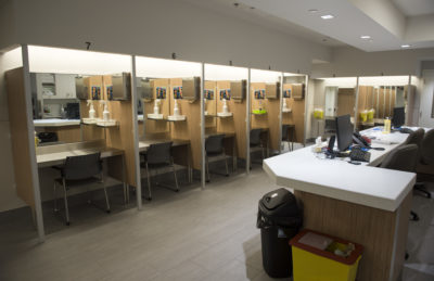 "In this June 2017 photo, booths line the Cactus ""safe injection site,"" where drug addicts can shoot up using clean needles, get medical supervision and freedom from arrest, in Montreal. (Paul Chiasson/The Canadian Press via AP)"