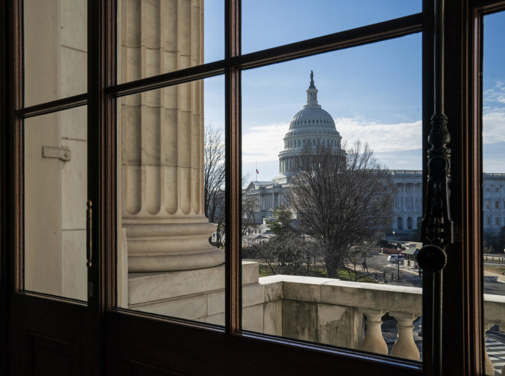 A view of the U.S. Capitol dome as seen through a window from the Russell Senate building on Dec. 27. (J. Scott Applewhite/AP)