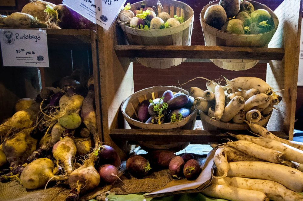 Assorted root vegetables at the Freedom Food Farm stand at the Somerville Winter Farmers Market. (Jesse Costa/WBUR)