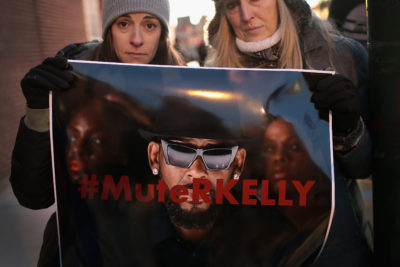 "Demonstrators gather near the studio of singer R. Kelly to call for a boycott of his music, after allegations of sexual abuse against young girls were raised on the highly rated Lifetime miniseries ""Surviving R. Kelly,"" on Jan. 9, 2019 in Chicago. (Scott Olson/Getty Images)"