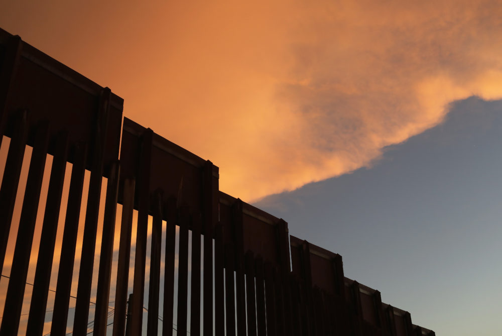 The fence marking the U.S.-Mexico border is seen at sunset on July 22, 2018 in Nogales, Ariz. President Trump has proposed replacing the fence with a wall. (John Moore/Getty Images)