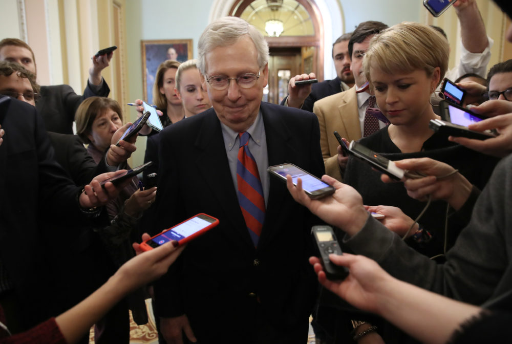 Senate Majority Leader Mitch McConnell (R-Ky.) smiles while talking with reporters following remarks on the Senate floor after an announced end to the partial government shutdown at the U.S. Capitol on Jan. 25, 2019 in Washington, D.C. (Win McNamee/Getty Images)