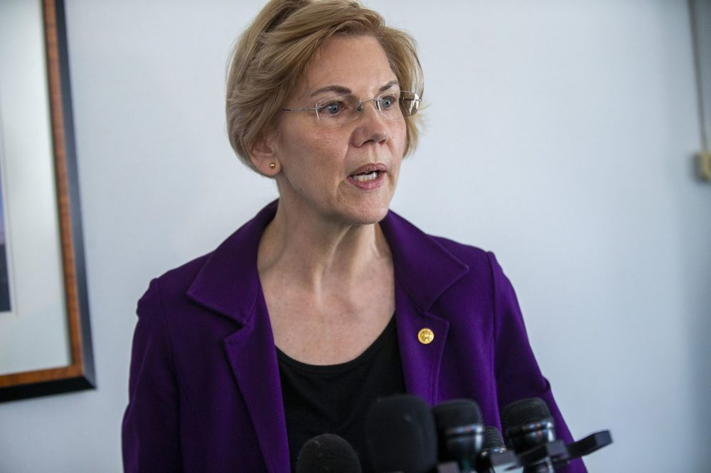 U.S. Seantor Elizabeth Warren answers questions from the news media after meeting with federal workers who were out of work during the recent government shutdown at the JFK Federal Building in Boston . (Jesse Costa/WBUR)