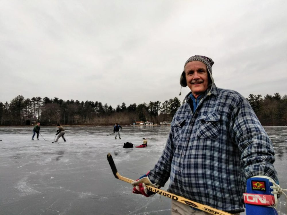 Massachusetts state geologist Steve Mabee, and UMass colleagues, marvel at the ice on Metacomet Lake in Belchertown, Mass., on Jan. 18. (Jill Kaufman/NEPR)