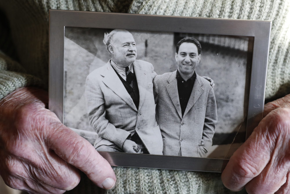Ernest Hemingway's close friend and biographer A.E. Hotchner holds a photograph of the pair together, Tuesday, Jan. 22, 2019, at the Hotchner family home in Westport, Conn. (Kathy Willens/AP)