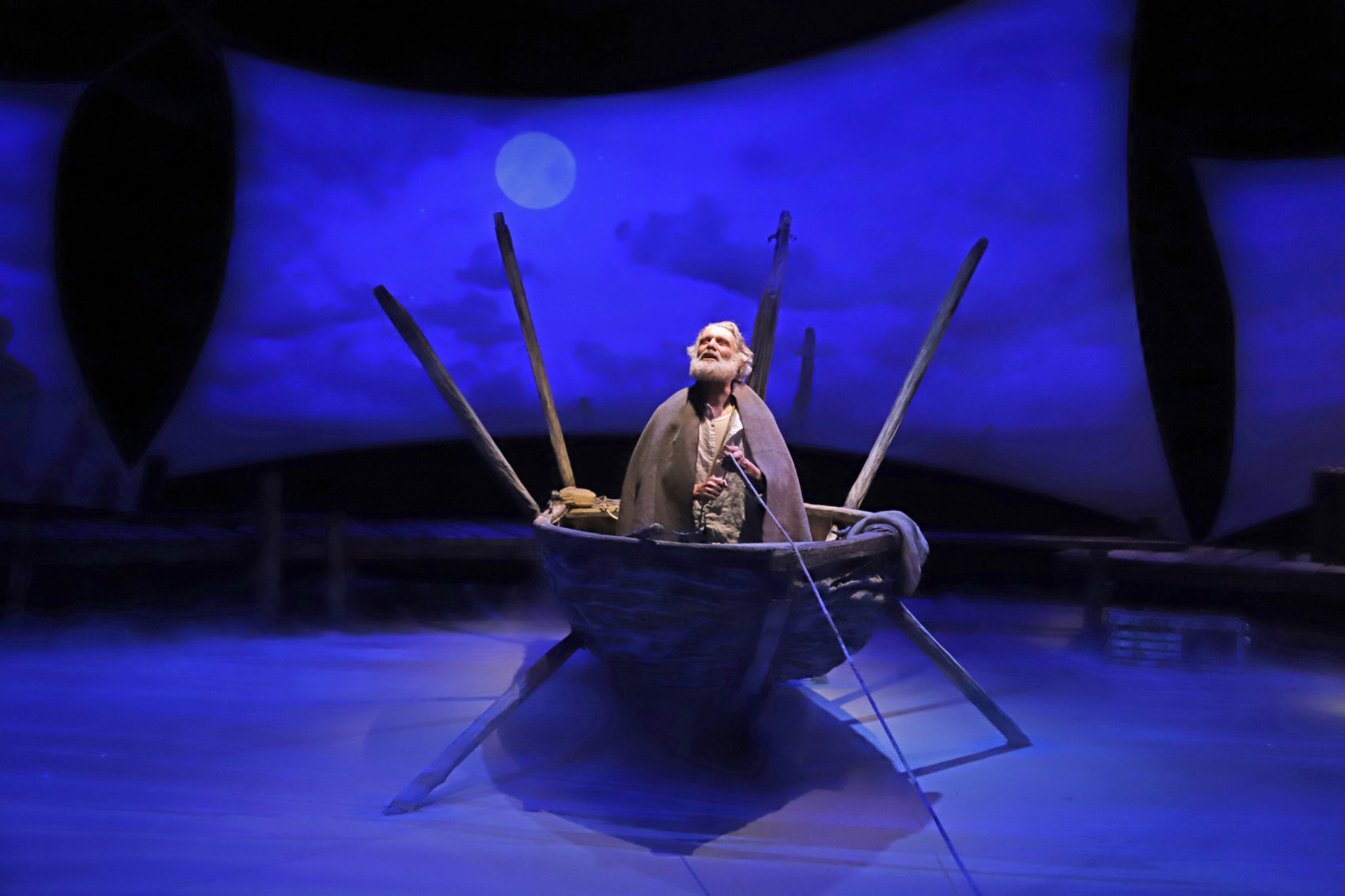 "Actor Anthony Crivello plays the roll of Santiago in a stage adaptation of Ernest Hemingway's ""Old Man and the Sea"" during a dress rehearsal at the Pittsburgh Playhouse in Pittsburgh Sunday, Jan. 27, 2019. The stage version was written by journalist and playwright AE Hotchner, the writer's confidant and fishing companion in Cuba during the period in which the novella was written, and his son Tim Hotchner. (Gene J. Puskar/AP)"