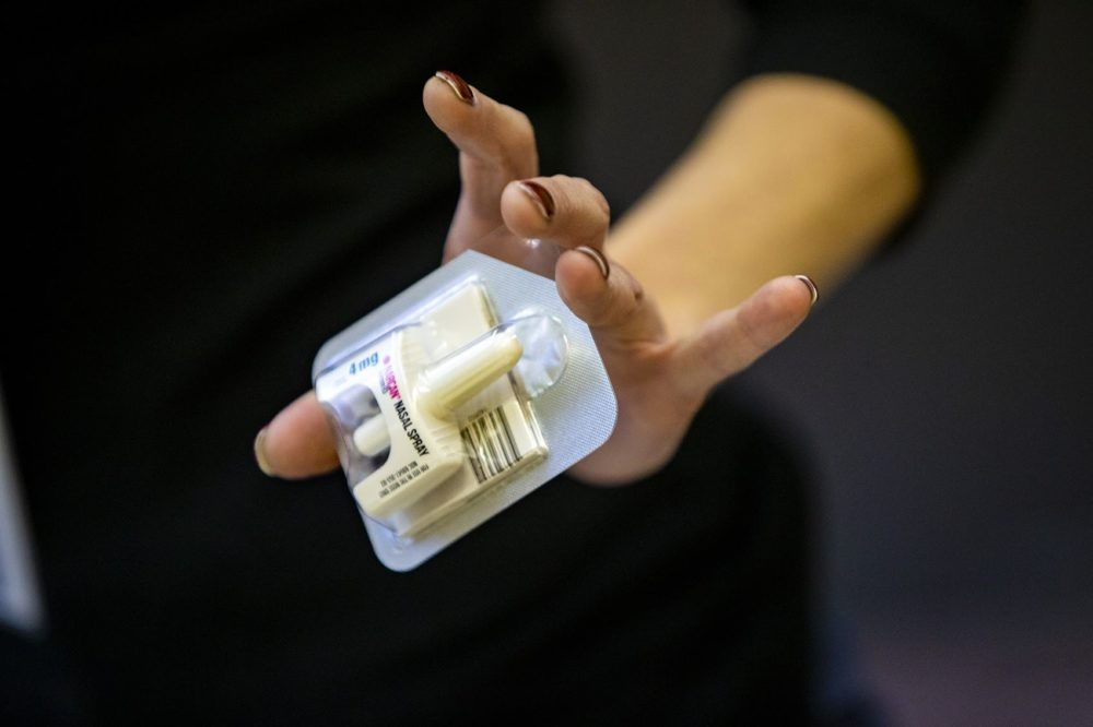 Amy Delaney, program manager at Boston Public Health, holds a single dose of Narcan nasal spray at the Overdose Prevention & Naloxone Training Program at Boston Medical Health Clinic. (Jesse Costa/WBUR)
