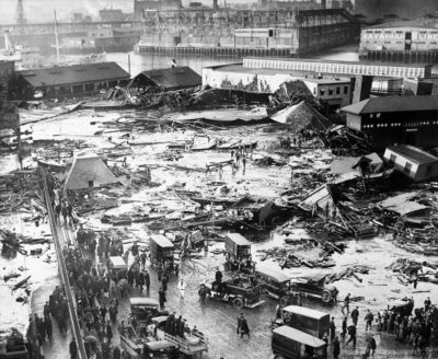 The ruins of a tank containing 2 1/2 million gallons of molasses lie in a heap after an eruption that hurled trucks against buildings and crumpled houses in the North End of Boston, on Jan. 15, 1919. The disaster took 21 lives and injured 40. (AP)