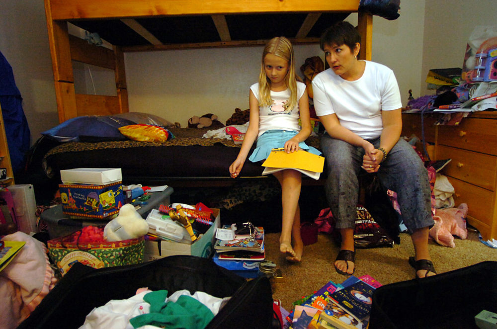 Aricia LaFrance, right, a psychologist and organizational consultant, advises Elphey Israel, 12, about cleaning and organizing her room at the Boulder Colo., apartment Elphey shares with her mother, Karen Lowe,  Aug. 21, 2005. (Sammy Dallal/AP)