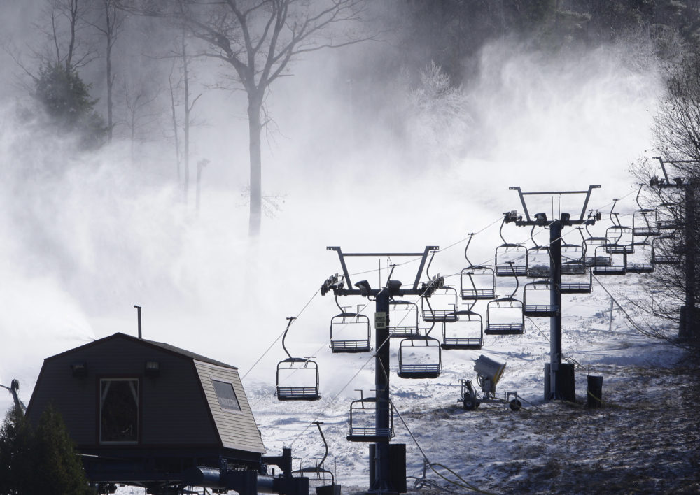Snow guns shoot powder over a trail at Wachusett Mountain ski area in Princeton, Mass., in this 2008 file photo. (Charles Krupa/AP)