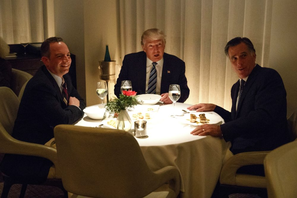 Donald Trump, center, eats dinner with Mitt Romney, right, and Reince Priebus at Jean-Georges restaurant, Tuesday, Nov. 29, 2016, in New York. (Evan Vucci/AP)