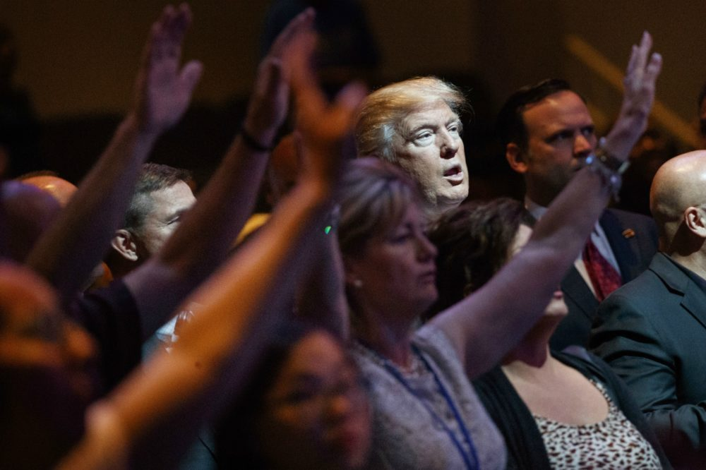 Donald Trump stands during a service at  the International Church of Las Vegas, Sunday, Oct. 30, 2016, in Las Vegas. (Evan Vucci/AP)