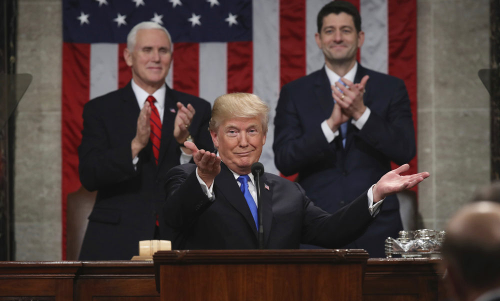 President Donald Trump gestures as delivers his first State of the Union address in the House chamber of the U.S. Capitol to a joint session of Congress Tuesday, Jan. 30, 2018 in Washington, as Vice President Mike Pence and House Speaker Paul Ryan applaud. (Win McNamee/AP)