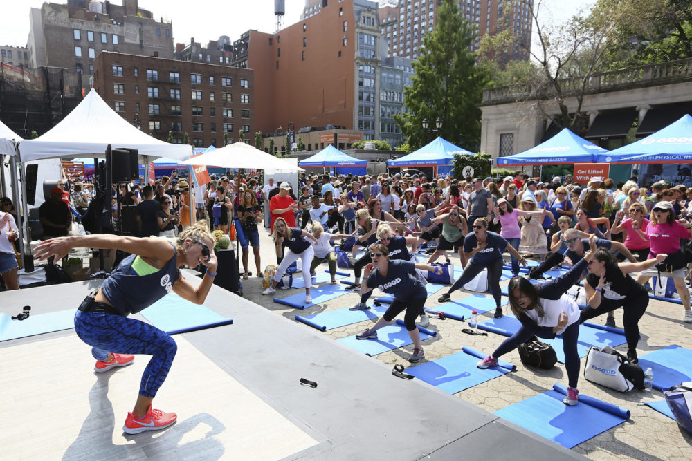 "At a WW GOOD wellness festival powered by Weight Watchers ""WW"" in Union Square, New York City residents engage in a movement and meditation series (""LIFTED"") led by Celebrity Fitness Instructor Holly Rilinger, Sunday, August 26, 2018. (Stuart Ramson/Weight Watchers via AP Images)"