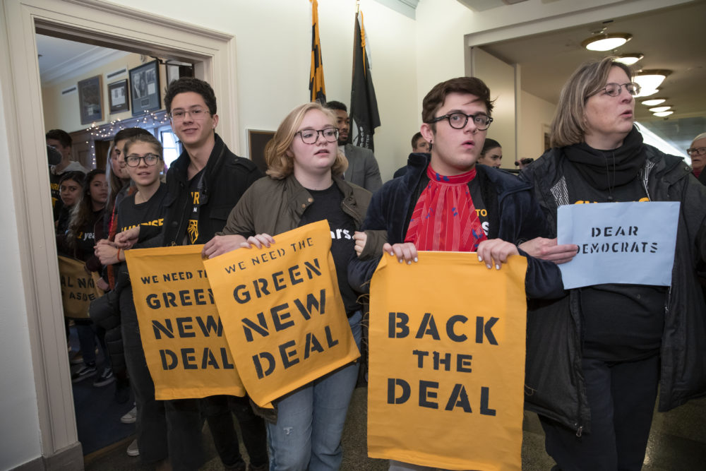 Environmental activists occupy the office of Rep. Steny Hoyer, D-Md., the incoming majority leader, as they try to pressure Democratic support for a sweeping agenda to fight climate change, on Capitol Hill in Washington, Monday, Dec. 10, 2018. (J. Scott Applewhite/AP)
