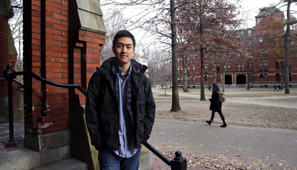 Harvard University graduate Jin K. Park, who holds a degree in molecular and cellular biology, poses at Harvard Yard in Cambridge, Mass., Thursday, Dec. 13, 2018.  Park, who was named a Rhodes Scholar along with 30 other Americans in November, entered the U.S. illegally as a child, moving to Queens borough of New York City with his family. The undocumented student, who participates in the Deferred Action for Childhood Arrivals program (DACA), is not sure if he'll be allowed back in the U.S. after his studies in the United Kingdom. (Charles Krupa/AP)