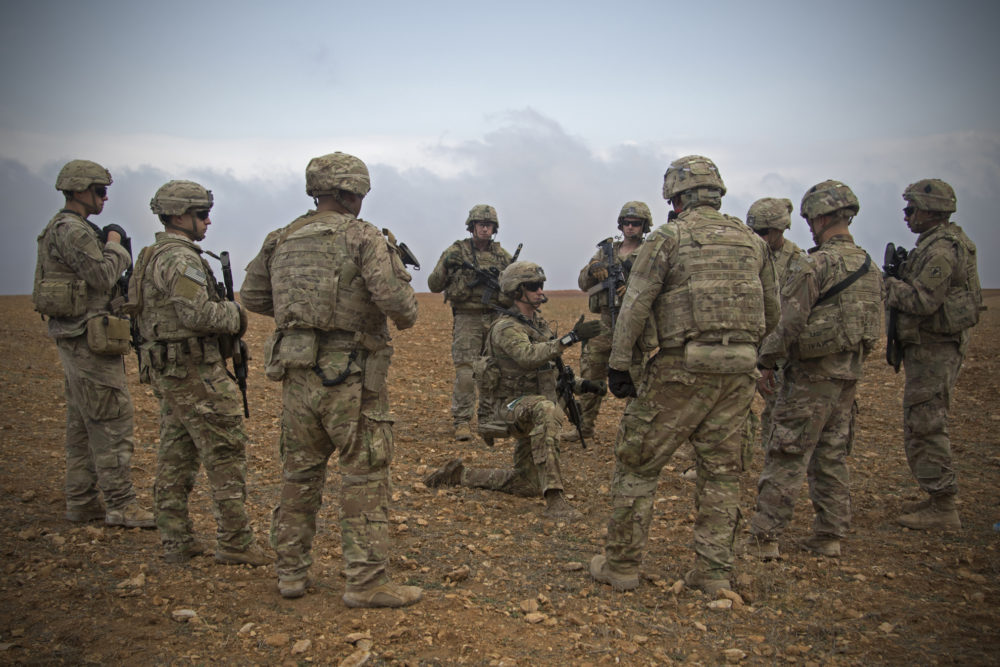 In this Nov. 7, 2018, photo released by the U.S. Army, U.S. soldiers gather for a brief during a combined joint patrol rehearsal in Manbij, Syria. (U.S. Army photo by Spc. Zoe Garbarino via AP)