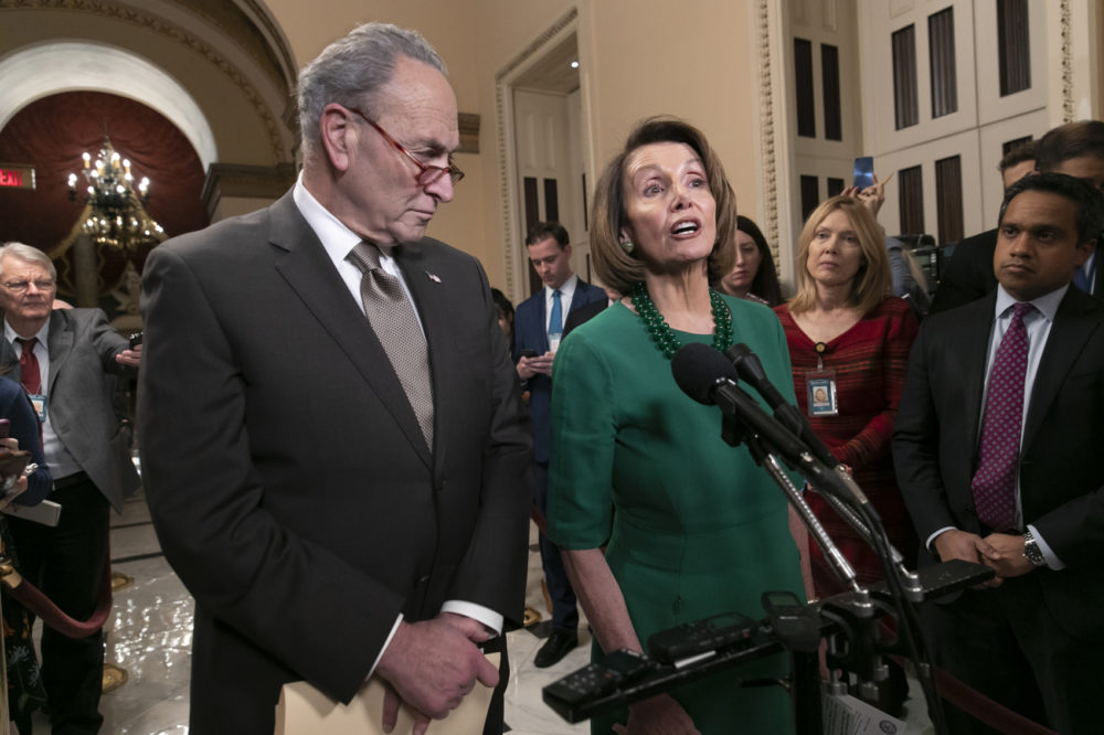 Senate Minority Leader Chuck Schumer, D-N.Y., and House Democratic Leader Nancy Pelosi of California, the speaker-designate for the new Congress, talk to reporters as a revised spending bill is introduced in the House that includes $5 billion demanded by President Donald Trump for a wall along the U.S.-Mexico border, as Congress tries to avert a partial shutdown, in Washington, Thursday, Dec. 20, 2018. (J. Scott Applewhite/AP)